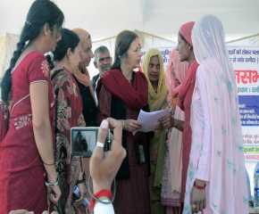 Women Giving Memo to Brinda