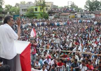Com. Surjya Kanta Mishra addressing a mass meeting in Deganga.