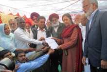 Hero Workers Handing a Memo to Brinda Karat
