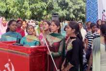 Women Singing at the Sirsa Meeting