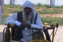 A Man on a Tricycle at Hanumangarh Meeting